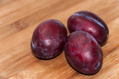 Close view of fresh plums on the wooden board Royalty Free Stock Image