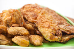 Close view of fried zucchini and mushrooms on a plate Stock Photos