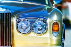 Old retro style car. Close view of the front fragment of the old style retro vintage car auto Stock Photo