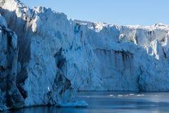 Close view front of natural Esmarkbreen glacier in Spitsbergen. Blue sky stock photo