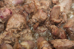 Close view of frying chicken livers in a pan Stock Images