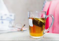 Close view of a glass of  tea with a teabag Royalty Free Stock Image