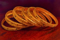 Golden bangles, Pune. Close view of Golden bangles at Pune Royalty Free Stock Photo