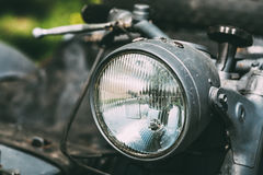 Close View Of Headlight Of Old Rarity Gray Tricar Or Three-Wheeled Motorbike With A Sidecar. Royalty Free Stock Image