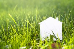 House of Paper on Sunlit Grass Stock Image