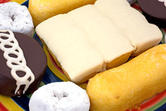 Close view of junk food cakes and donuts Stock Image