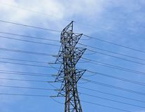Electricity transmission tower. Close view on a large high voltage electricity transmission tower stock photo