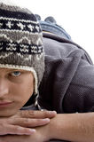 Close view of laying young male wearing winter cap Royalty Free Stock Photo