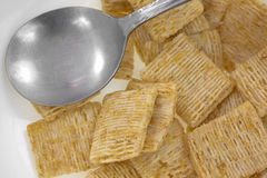 Close view of leftover cereal in bowl with spoon Stock Photography