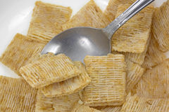 Close view of leftover cereal in bowl with spoon Royalty Free Stock Image