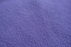 Close view of violet fleece fabric. Close view of light violet fleece fabric Royalty Free Stock Photos