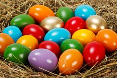 Close view of colorful Easter eggs in nest Stock Photo