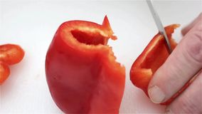 Close view of a man cutting bell pepper stock video