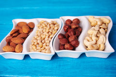 Close view at mixed of nuts in wave plate Royalty Free Stock Image