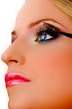 Close view of model putting eyeliner Stock Photography