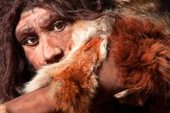 Neanderthal expression. Close view of a neanderthal man, focused in eyes expression stock images