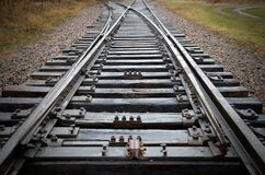 Free Close View Of Dark Wet Railroad Tracks To Unknown Destinations Royalty Free Stock Image - 180163566
