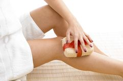 Close View Of Female Scrubbing Her Legs Royalty Free Stock Images