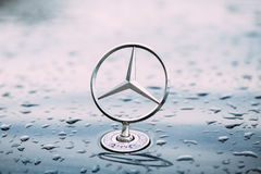 Free Close View Of Metal Star Logo Of Mercedes Benz At Wet Hood Of Blue Stock Image - 90747661