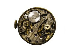 Steel clockwork of old mechanical wristwatch. Isolated on white background. Close view of old clock mechanism with gears and cogs.Isolated on white background Stock Photos
