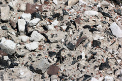 Close view of old construction debris and demolition waste. Sand, expanded clay, small stones and rubbish Royalty Free Stock Photo