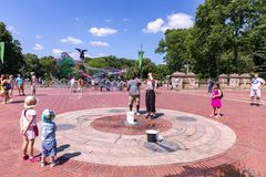 People in front of Bethesda fountain in Central Park create gigantic soap bubbles on a sunny day royalty free stock photography