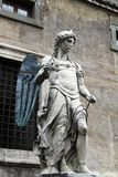 Bernini angel statue. Close view of one of Bernini's statues of an angel in the bridge near  Sant'Angelo Castle in Rome, Italy Royalty Free Stock Photos
