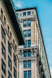 Close view of ornament on the building exterior of American Woolen Building in Gramercy district New York City stock photos