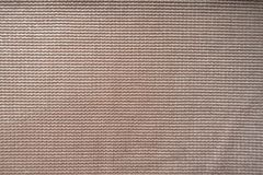 Close view of pale pink polyester fabric. Close view of pastel pink polyester fabric Royalty Free Stock Image