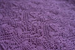 Close view of pink handmade knitted lace. Close view of pink hand made knitted lace royalty free stock photography