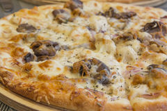 Close view of pizza. View of pizza, famous italian food with narrow depth of field Royalty Free Stock Photography