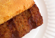 Close view of a pork rib sandwich Royalty Free Stock Photography
