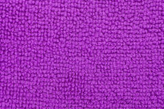Close view of a purple microfiber sponge. A very close view of a purple microfiber kitchen sponge stock photography