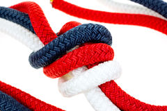 Close view of a red white and blue rope knot Stock Photos