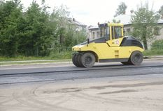 Close view on the road roller working on the new road construction site.repair.  royalty free stock photo