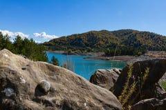 Rocks and vegetation at Aoos artificial lake in Epirus, Greece Stock Image