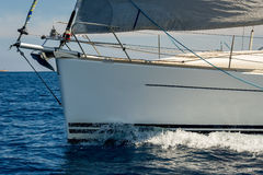 Close view at sailboat bow with hoisted genoa is sailing in the Mediterranean Royalty Free Stock Images