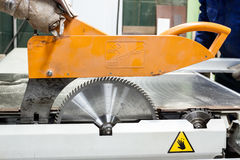 Close view on saw machine at carpenters workshop. Stock Photos