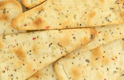 Close view of seasoned pizza crust chips Stock Photography
