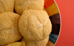 Close view of sesame seed bulky rolls on a plate Stock Photo