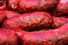 A Close view of several colored salamis stock images