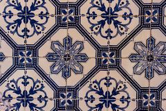 Close view of several white and blue tiles with decorative guards royalty free stock photography