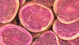 Close View Sliced Raw Purple Potatoes Royalty Free Stock Photo