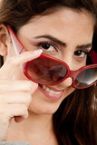 Close view of smiling model holding sunglasses Stock Image