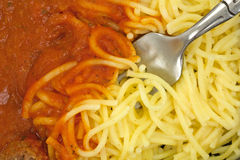 Close view of spaghetti with tomato sauce and fork Royalty Free Stock Photos