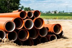 Orange plastic pipes Stock Photography