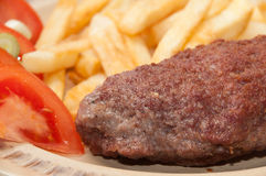 Close view at the stuffed burger on the plate Stock Images