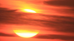 Close view sunrise through light clouds. Sunrise sun disk from cirrus clouds sky time-lapse stock video