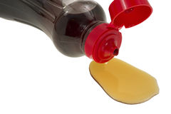 Close view syrup spilling from container Royalty Free Stock Image