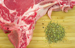 Close view t-bone steak and seasoning Royalty Free Stock Image